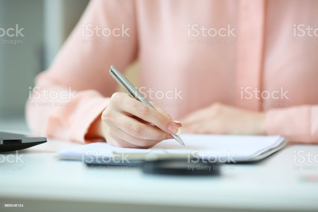 Business woman holding a pen in his hand, and signed a contract, with depth of field image stock photo