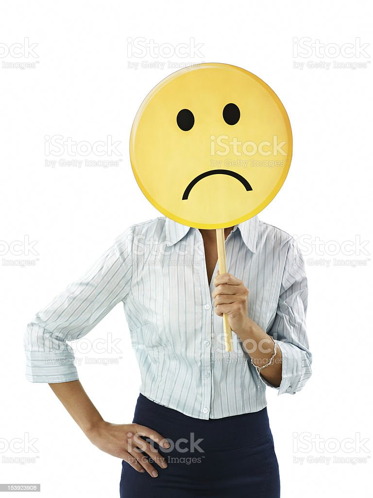 Business woman holding a sad face emoticon stock photo