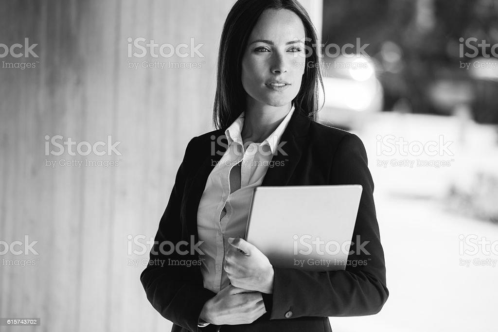 Business woman holding a tablet pc (art development) stock photo