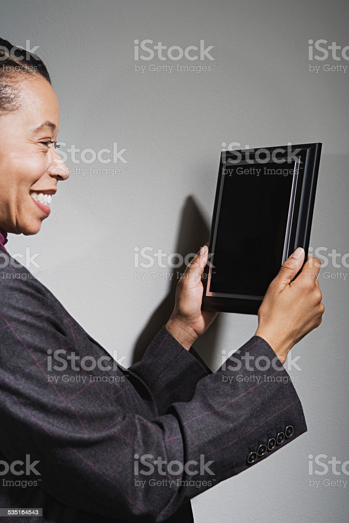 Business woman holding an award stock photo