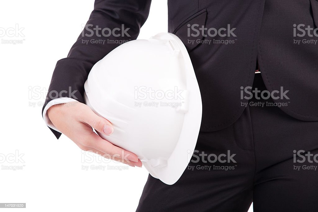 Business woman holding an helmet stock photo