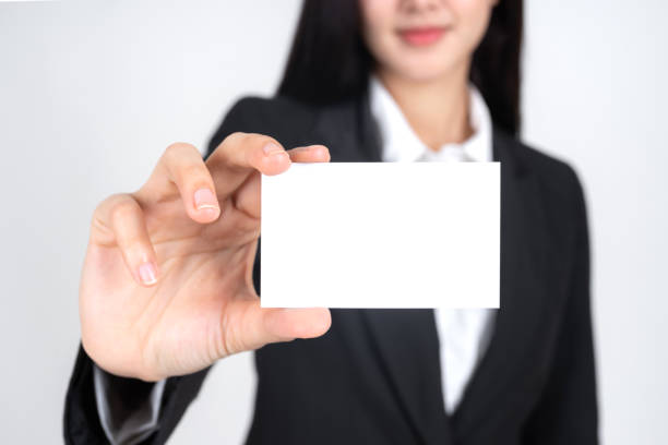 business woman  holding and showing empty business card or name card - business concept stock photo