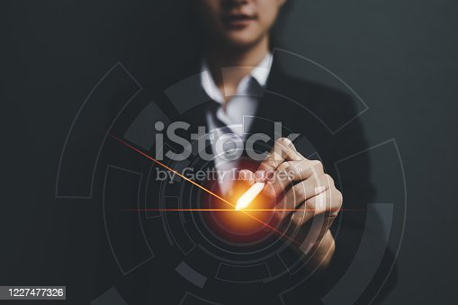 Business woman holding darts with virtual screen dart board .targeting the business concept.