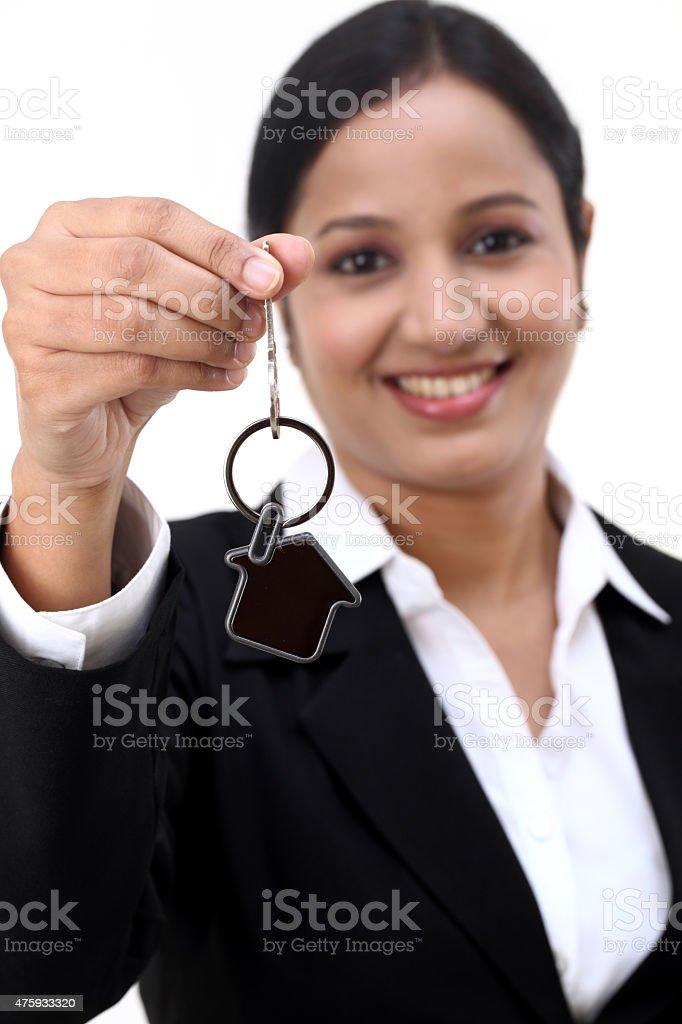 Business woman holding house key stock photo