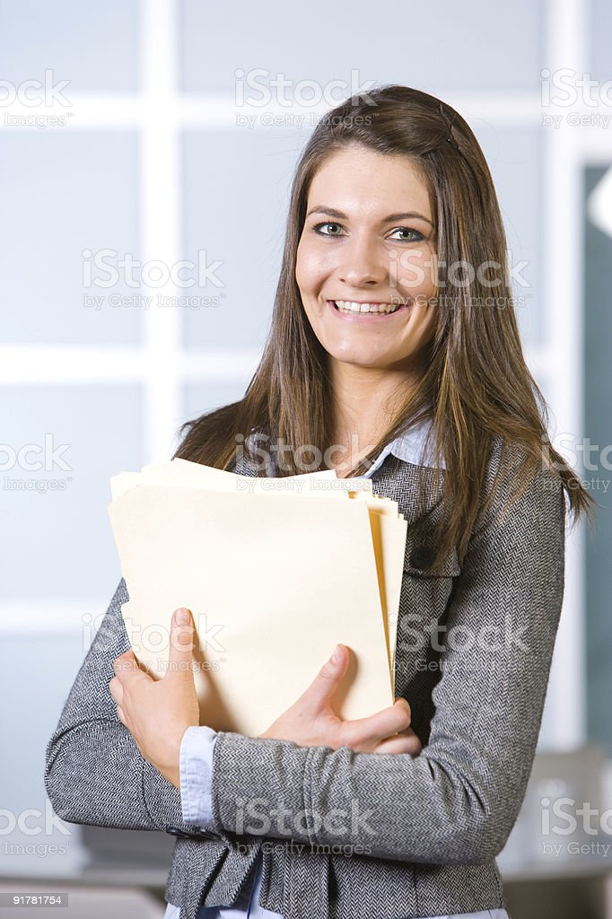 Business woman holding legal documents in modern office royalty-free stock photo