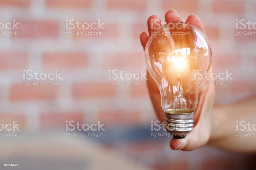 business woman holding light bulbs royalty-free stock photo