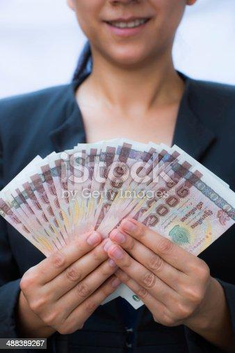 istock Business woman holding money 488389267