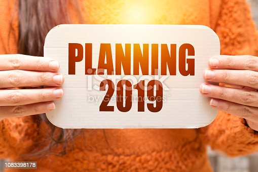 istock business woman holding white carton  paper with planning 2019 text 1083398178