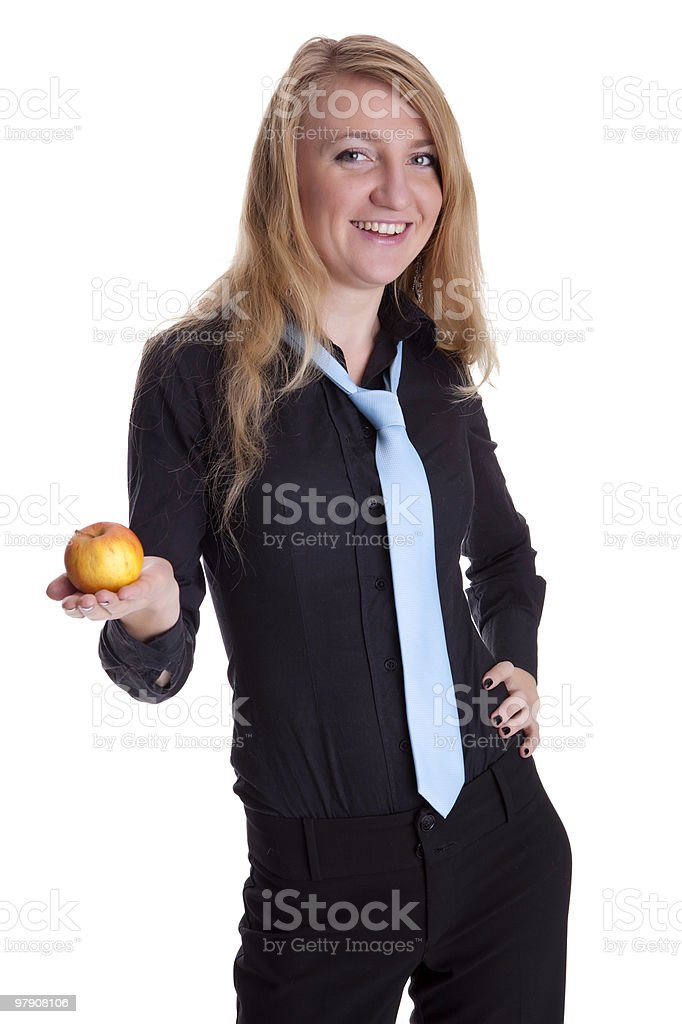 Business woman holds a apple and smiles royalty-free stock photo