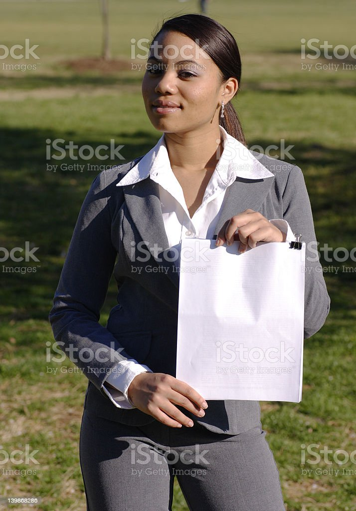 Business woman holds blank sign outside royalty-free stock photo