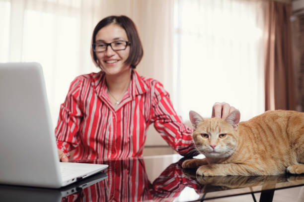 Business woman in a red shirt with a ginger cat at home picture id1296329198?b=1&k=6&m=1296329198&s=612x612&w=0&h= sezk9vj42cvepxhn7fomyytphxnspkcitdzpxm5w80=