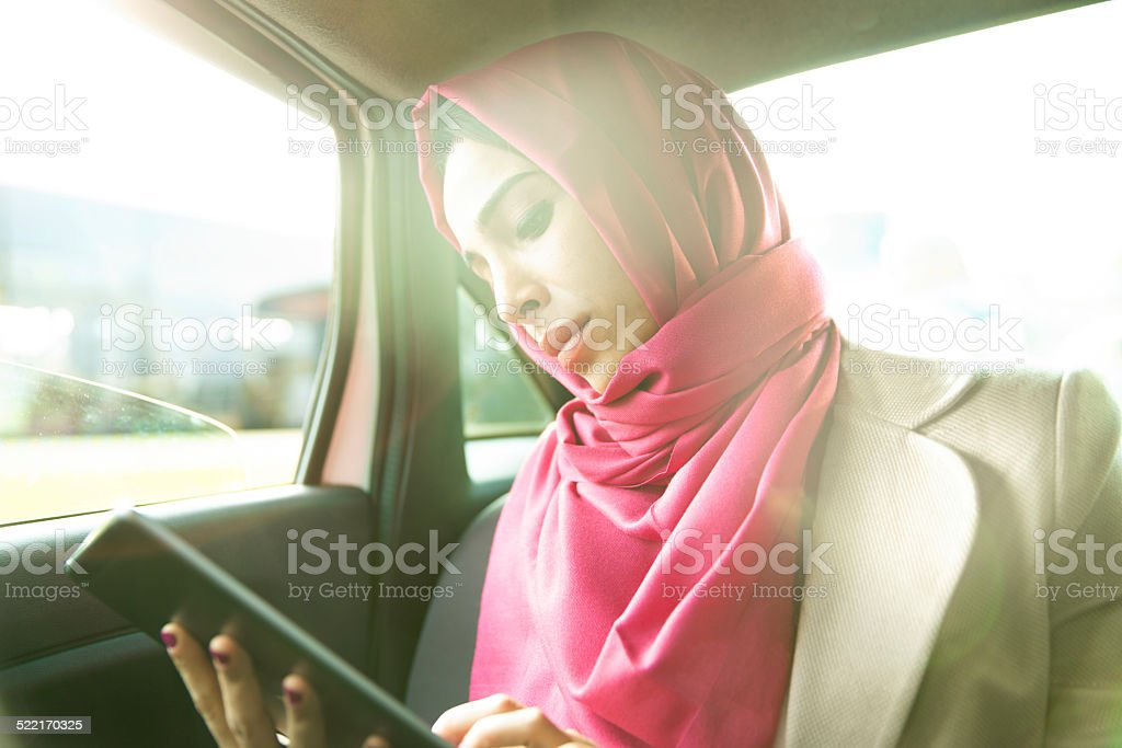 Business Woman In A Taxi stock photo