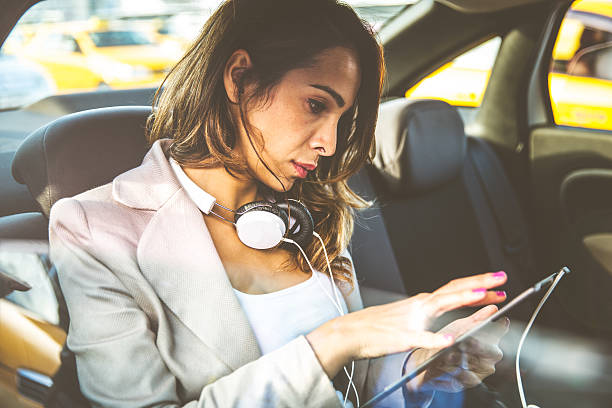 business woman in a taxi - 30 39 years stock photos and pictures
