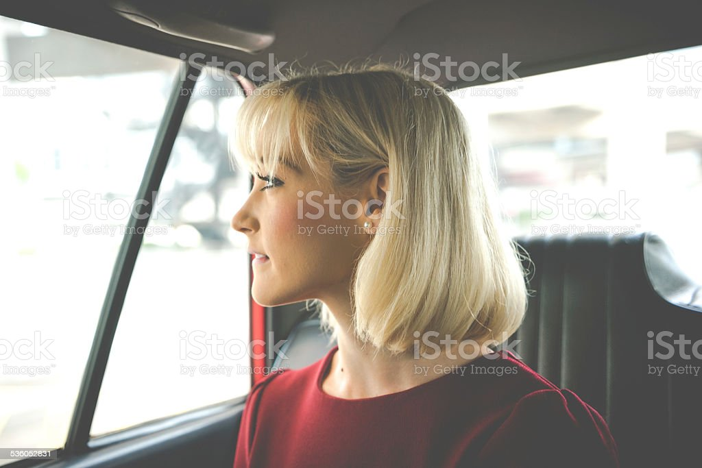 Business Woman In A Taxi Businesswoman in a taxi. 2015 Stock Photo