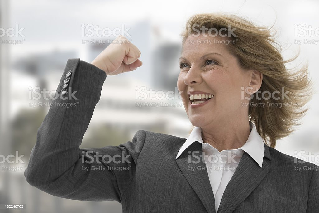 Business woman in a victorious pose royalty-free stock photo