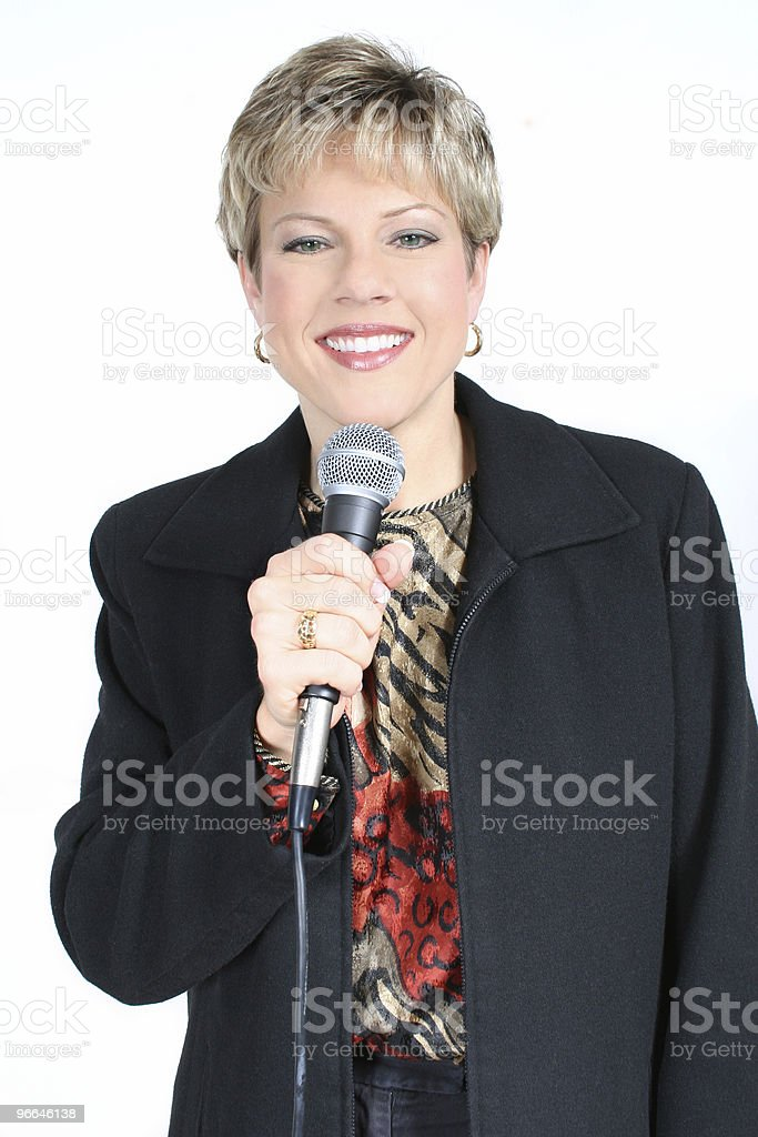 Business Woman in Black with Microphone royalty-free stock photo