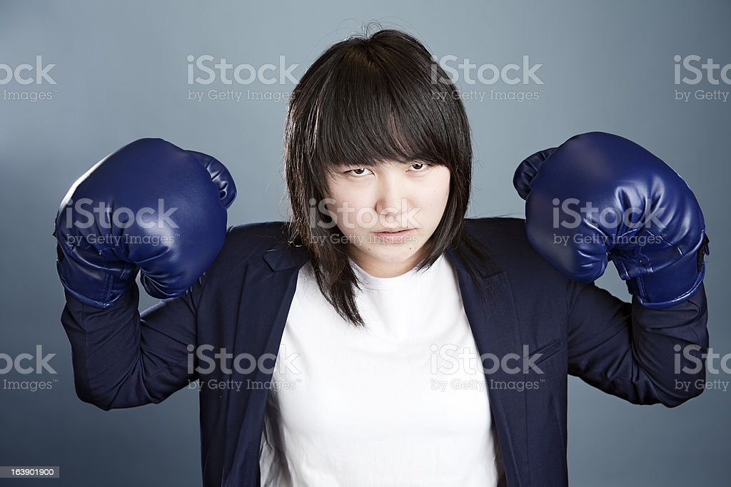 Business woman in boxing gloves royalty-free stock photo