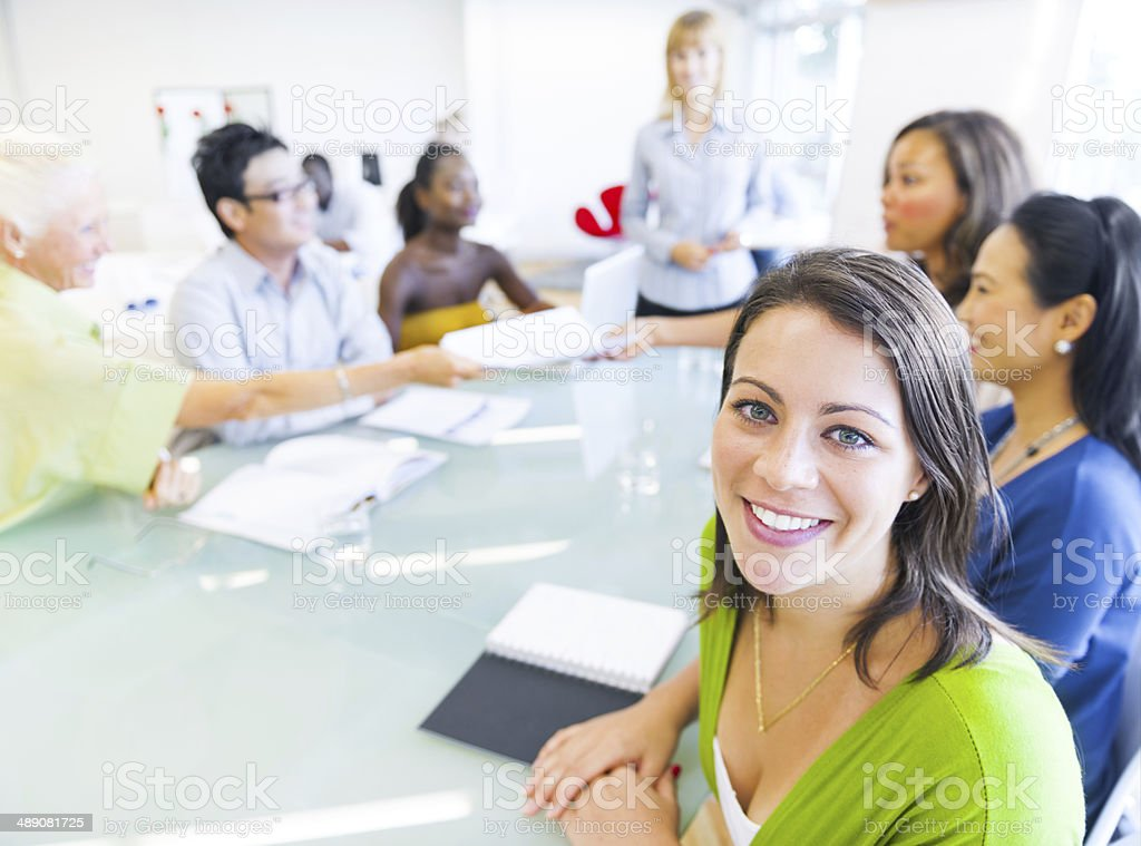 Business Woman in Conference with Associates stock photo