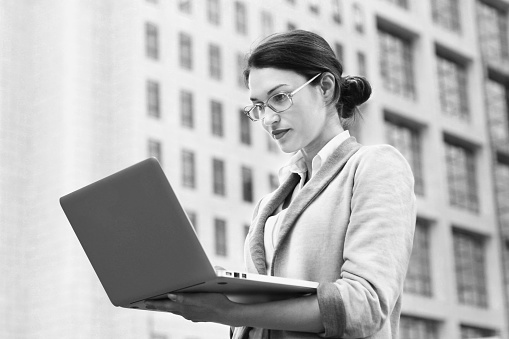 istock Business woman in front of building BNW 615924408