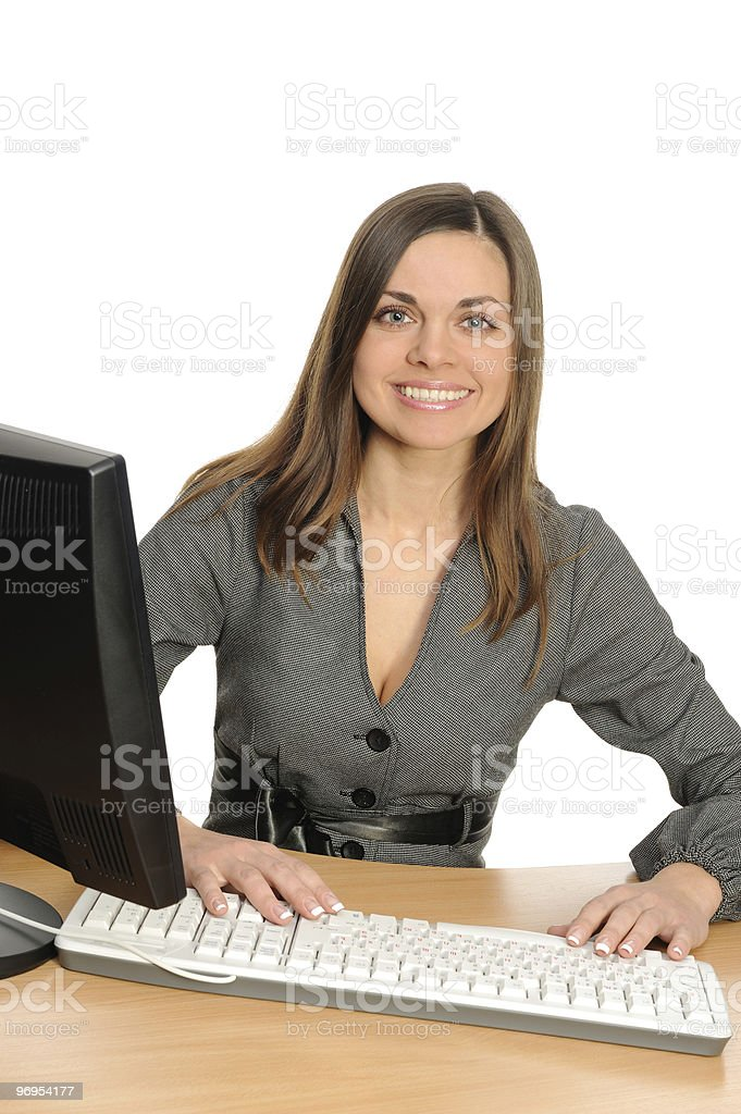 Business woman in front of her desktop computer royalty-free stock photo