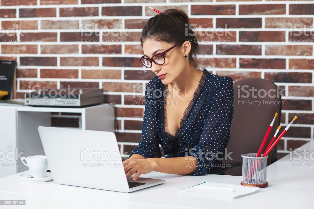 Business woman in glasses portrait working on a laptop royalty-free stock photo