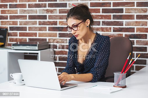 Business Woman In Glasses Portrait Working On A Laptop Stock Photo & More Pictures of 30-39 Years