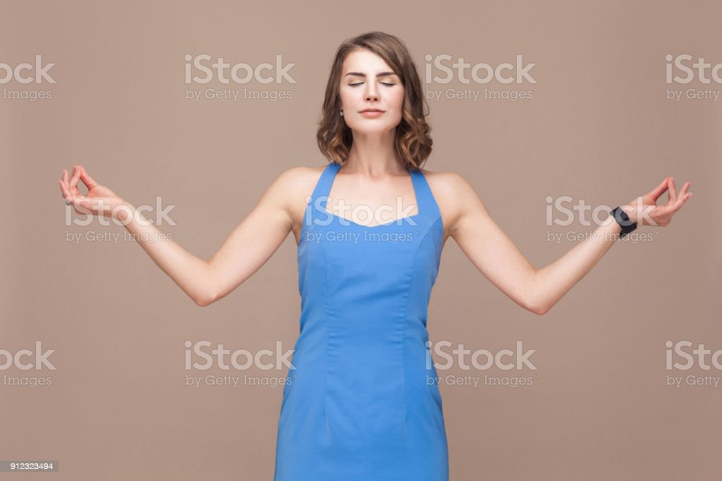 Business woman in harmony. Well dressed lady doing yoga asana stock photo