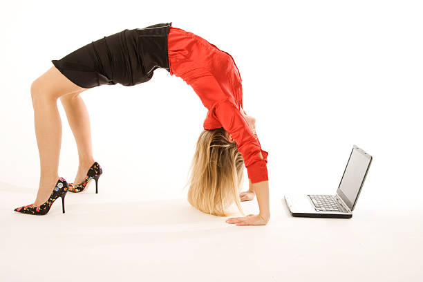 Business woman in heels doing back bend near laptop Similar corporate images: bending over backwards stock pictures, royalty-free photos & images