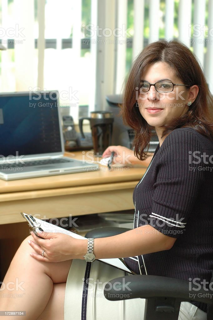 Business woman in her desk royalty-free stock photo