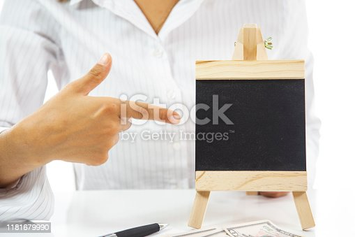 business woman in office is showing blank chalkboard