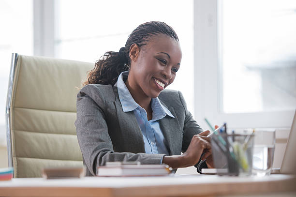 Business woman in office stock photo