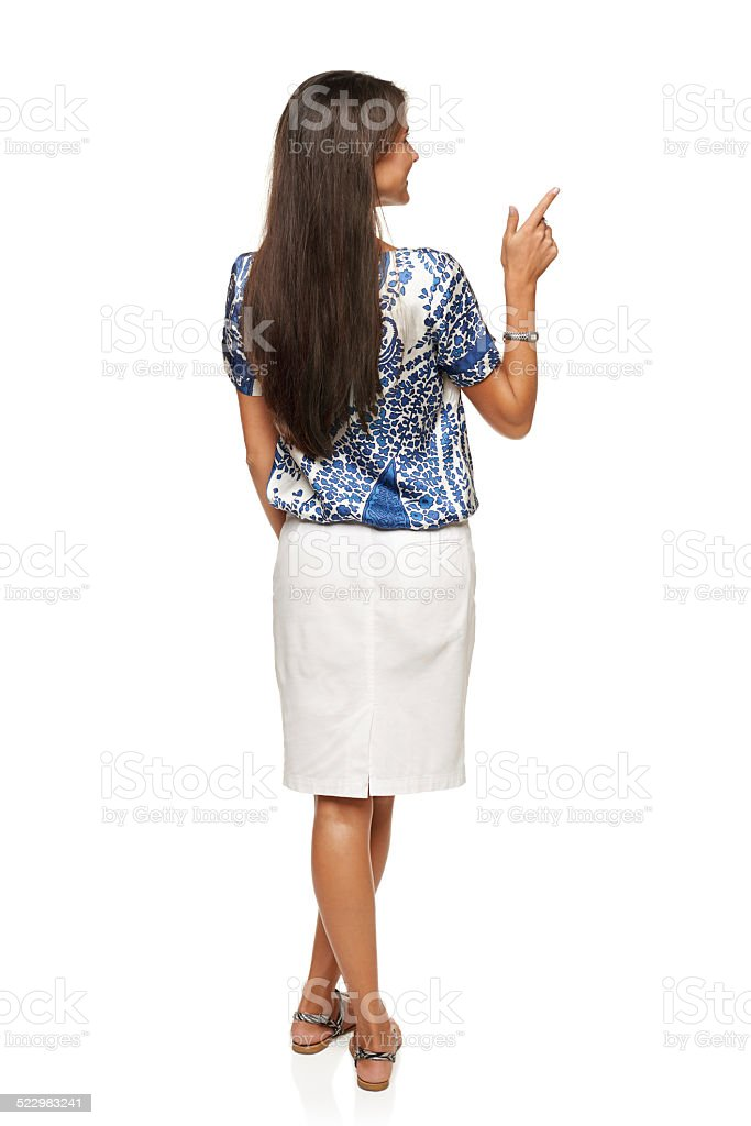 Business woman in pointing at copy space stock photo
