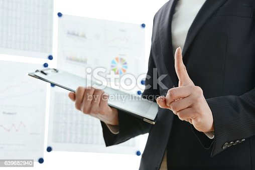 istock Business woman in presentation 639682940