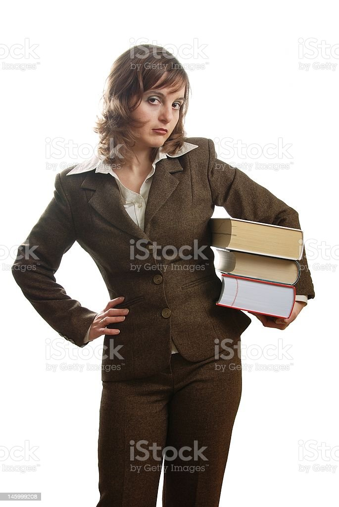 Business woman in suit wearing books with angry look royalty-free stock photo