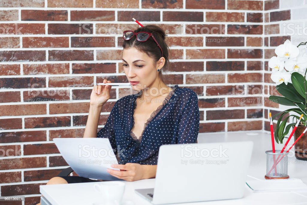 Business woman in the office an the desk verifying documents. royalty-free stock photo