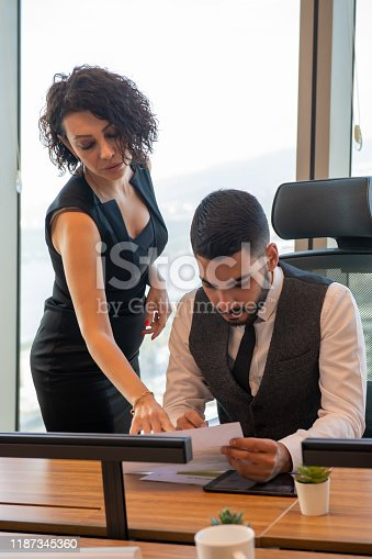 Business woman in the office tells the files to the boss