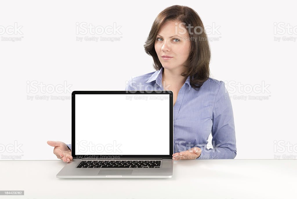 Business woman is sitting in front of laptop stock photo