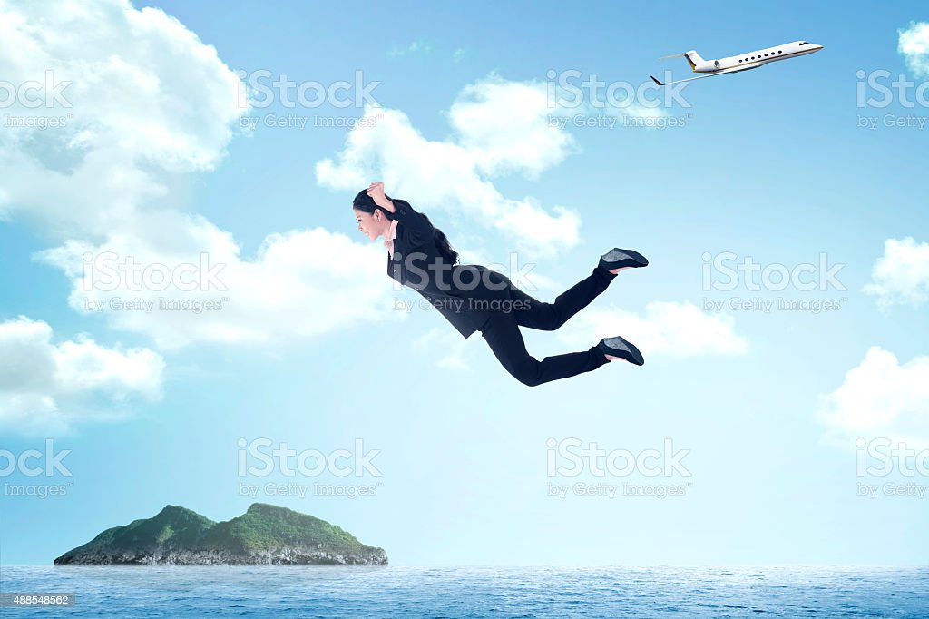 Business woman jumping from airplane stock photo
