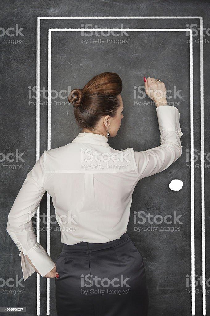 Business woman knock on door stock photo