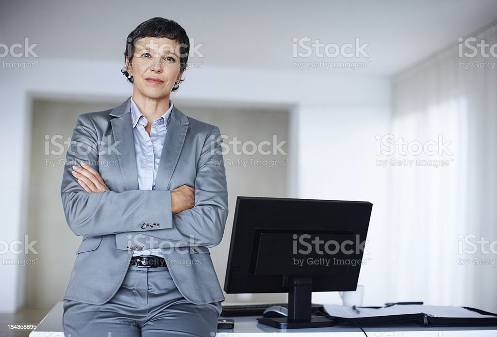Business woman leaning on office desk royalty-free stock photo