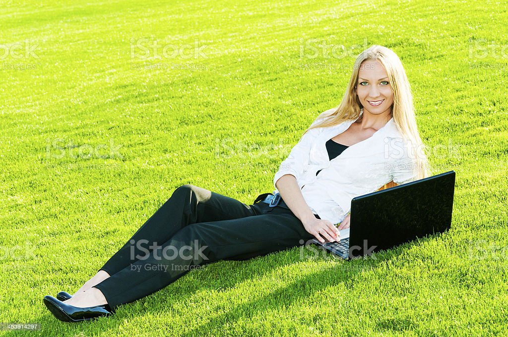 Business woman lies on the grass royalty-free stock photo