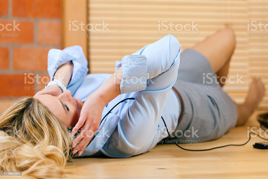 Business woman listening music or language course royalty-free stock photo