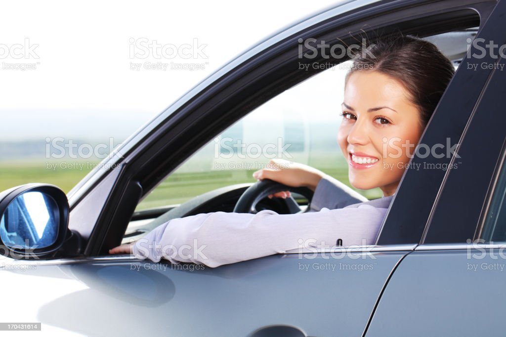 Business woman looking at camera through the car window. royalty-free stock photo