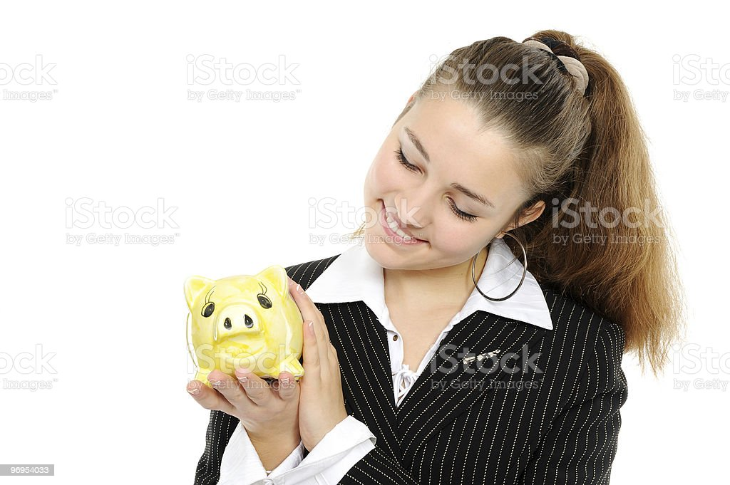 business woman looking at her savings in a piggy bank royalty-free stock photo
