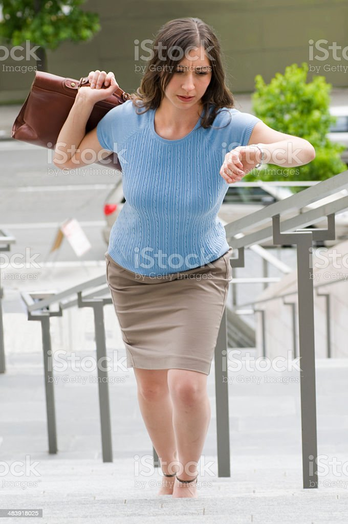 Business Woman Looking at her Watch royalty-free stock photo