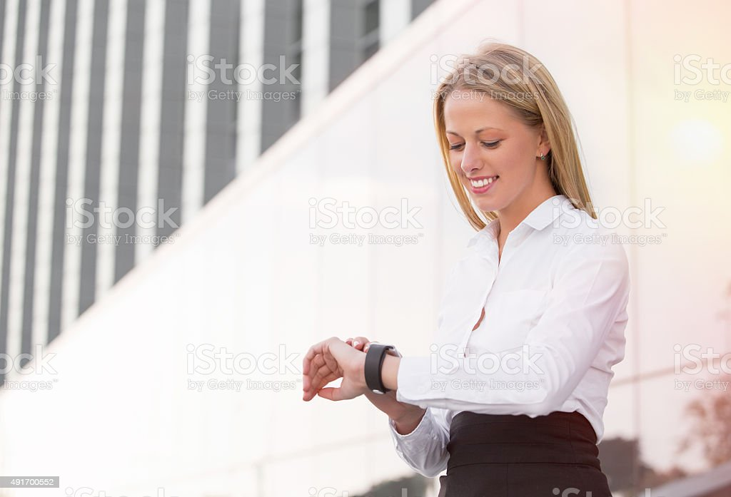 Business woman looking at watch stock photo
