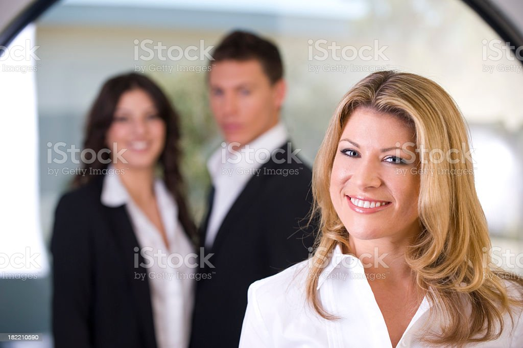 Business woman looking confident with staff royalty-free stock photo