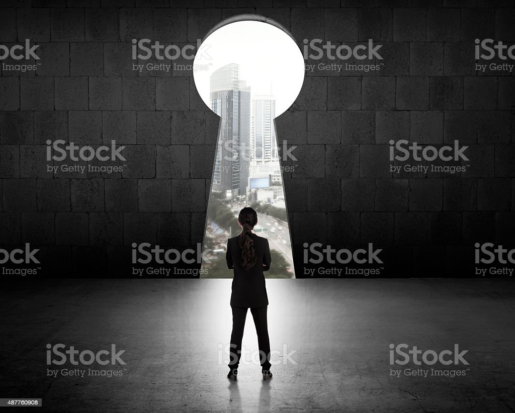 Business Woman Looking Through Key Hole stock photo