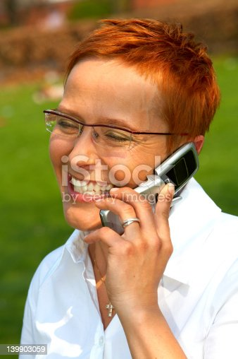 1150572074istockphoto Business woman making a phone call. 139903059
