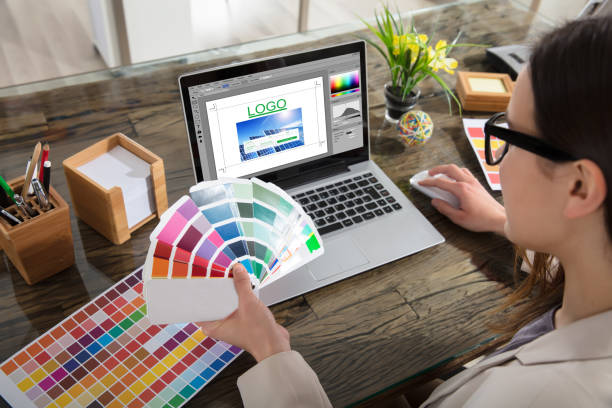 business woman making color selection for logo design - logo imagens e fotografias de stock